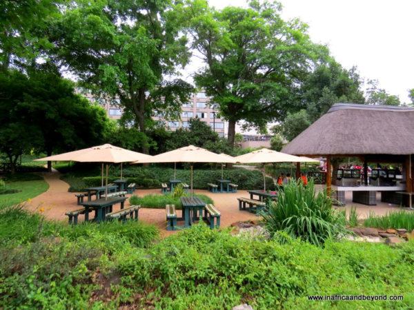 Riverside Sun Hotel gardens and pool bar area