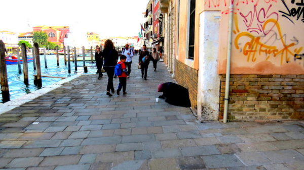 Beggars - An old woman begging in Venice