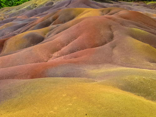 Close up of colored Seven Earths of Chamarel, a geological phenomenon created by volcanic activity and different cooling times. Mauritius, Indian Ocean. Bucket List